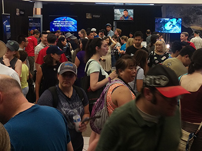 Crowds flock to the Earth Sciences exhibits during the NASA Jet Propulsion Laboratory (JPL) Open House event, giving volunteers (red shirts) a chance to share information about their various missions.